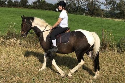 Lady sitting on horse