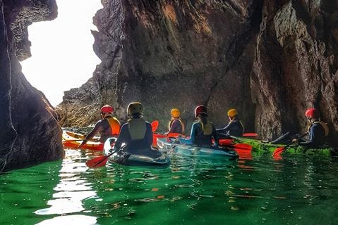 Kayakers in a sea cave